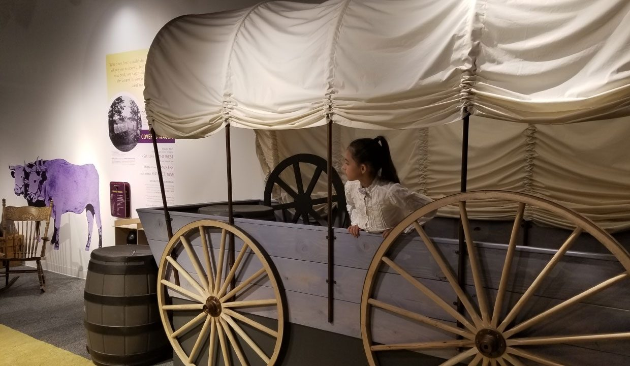 Girl in old wagon