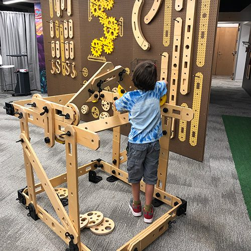 Boy playing on wooden structure