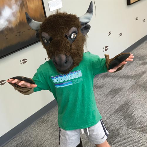Boy with buffalo mask